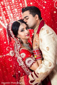 This Indian bride and groom pose for lovely portraits.