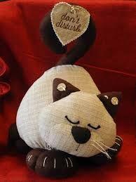 Risultati immagini per gatto di stoffa fermaporta