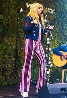 Kali Uchis getting her retro game on in ASOS 70s stripe print flare trousers for the Great Escape festival in Brighton <3