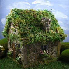 "I especially like the small stones covering the walls, the ""timber"" corners, and the mossy roof. Very rustic little fairy cabin. Can use a birdhouse base."