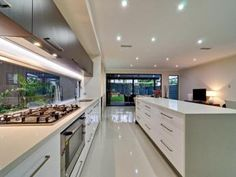 Modern island kitchen design using stainless steel - Kitchen Photo 818898