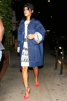 Rihanna was photographed at Giorgio Baldi wearing an oversized jean jacket over a t-shirt worn as a dress, plus candy-colored Christian Louboutin stilettos that transformed the whole look into a, well, lewk.