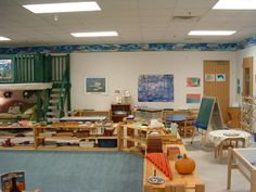 preschool classroom / like the carpet area marked out and separated by 'through' shelves (ECE 2-6)