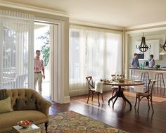Add a touch of illuminating radiance to holiday entertaining with the soft light transforming beauty of Luminette® Privacy Sheers. A perfect window treatment designed to cover large windows and doors with superior light control and easy operation. ♦ Hunter Douglas window treatments