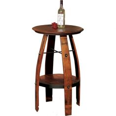 Bistro Pub Table A unique look! This pub table is made from retired recycled wine barrels and rough sawn lumber. The shelf provides for easy storage and a spot for interesting decor!