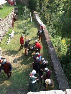 Reenactment at Castle Malesov, Kutna Hora, Czech Republic. September 2, 2012. Lovely reenactors prepare for a cannon demonstration.