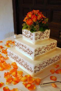Ovation Photography & Design - Square wedding cake with orange roses.