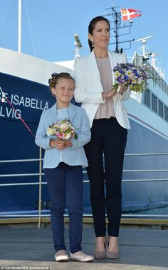 Lookalikes: Holding matching posies, the mother-daughter-duo stood stoically at the bow of the Isabella as the vessel wash christened.