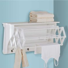 Accordion Drying Rack in the laundry room for drying clothes