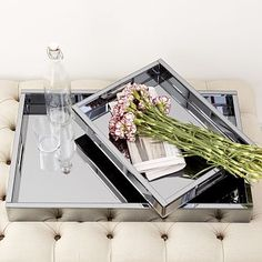 Add to the breakfast-in-bed surprise with a brand new set of serving trays like these blue mirrored glass trays by West Elm.    .  Gift Ideas For the Home by Design Connection, Inc. | Kansas City Interior Design http://designconnectioninc.com/blog/ #ServingTray #InteriorDesign #KansasCity