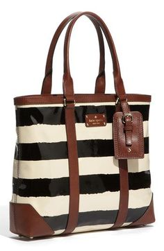 kate spade tote with iPad and cell phone pockets.  love the black and ivory with brown