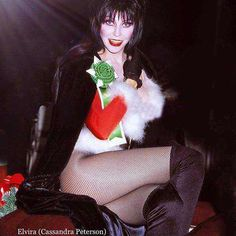 Image may contain: 1 person, sitting Dark Beauty, Gothic Beauty, Elvira Movies, Broly Ssj3, Pin Up Girl Vintage, Vintage Woman, Divas, Cassandra Peterson, Goth Women