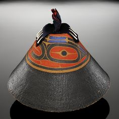 Hat of a high-status woman, probably Nuu-chah-nulth (Nootka) (attributed); formerly identified as Haida, 1800-1830, Cedar bark, spruce root, paint, wool cloth, dentalium shell/shells
