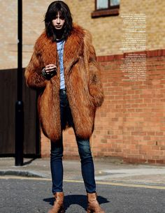 Fur, jeans, and booties in Vogue Russia, November 2014.