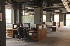 Dark painted Conduit - wood desk, carpet, Amazon offices