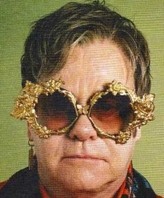 Only custom Prada glasses for Sir Elton. Custom made...you think?! I thought you'd just be able to pick these off the shelf at Vision Express!