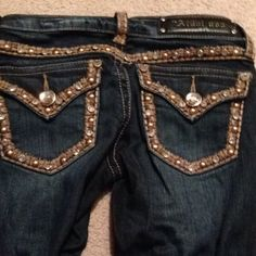 LA Idol Boot cut Blingy Jeans Very cute LA Idol Boot Cut Jeans. Lots of bling! Used. Brand tag on the back has a missing L for LA. Size 0. LA Idol Jeans Boot Cut