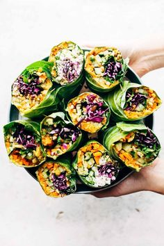 Rainbow Roll-Ups - with curry hummus and veggies in a collard leaf, dunked in peanut sauce! most beautiful healthy desk lunch! | pinchofyum.com