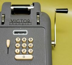 vintage adding machine.  I worked with a  man that could punch those numbers in an fling that handle so fast!!