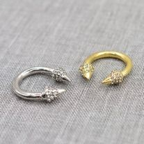 A very trendy ring design, studded with rhinestones. Available in gold and silver.  Material: alloy with silve/gold plated, rhinestone Size: 7