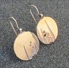 Colin Duncan earrings, mixed metal, found objects.