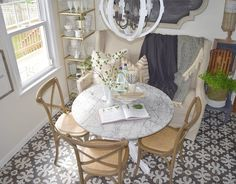 White Kitchen remodel with patterned tile and butcher block counter tops. Eat-in banquette. Countertop Concrete, Butcher Block Countertops, Living Room Chairs, Dining Chairs, Dining Table, Lounge Chairs, Dining Rooms, Dining Area, Ikea