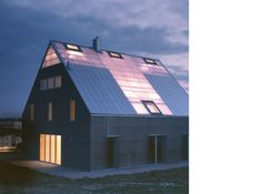 Polycarbonate-translucent roof; Patchwork-Haus by Pfeifer Roser Kuhn