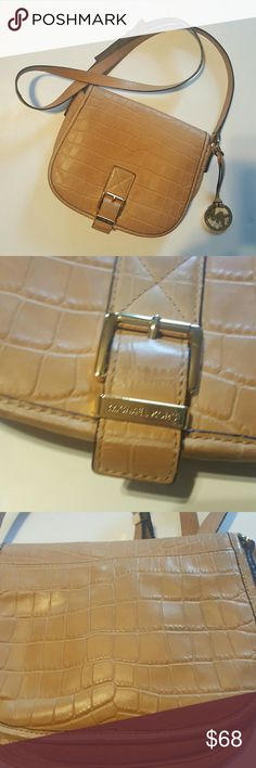 Authentic Michael Kors Handbag Last Price!! Crossbody style has some denim stains in the back of the purse inside has no stains Michael Kors Bags Crossbody Bags