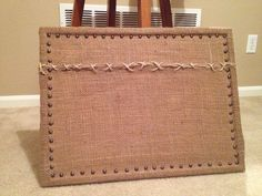 Cork board covers in burlap and pinned in. Buy craft supplies at lowes or Home Depot. Sooo much cheaper