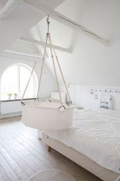 Space saving - Leander cradle, the hanging bassinet is supposed to provide security and stimulate development. or you could just hang a moses basket over your bed ; Hanging Bassinet, Hanging Crib, Hanging Cradle, Baby Bassinet, Baby Crib, Moses Basket, Baby Bedroom, White Bedroom, Nursery Design