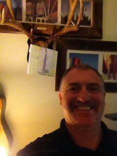 Marcus' art is hanging on what looks like an 8-point rack! Learn more: youtu.be/aq9MGBXQxmY #autism