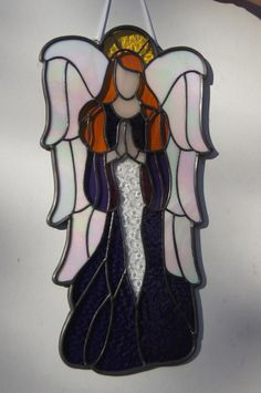 A pretty purple stained glass angel custom-made for a woman in the Phoenix area. Her plan is to give this angel to her mother for Christmas if she doesn't decide to keep it herself.