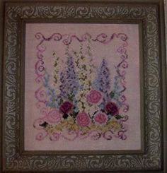Country Garden Stitchery Floral Symphony - Cross Stitch Pattern. The model was stitched on 28 Ct. Cameo Rose Cashel linen with DMC floss, Mill Hill beads, and T