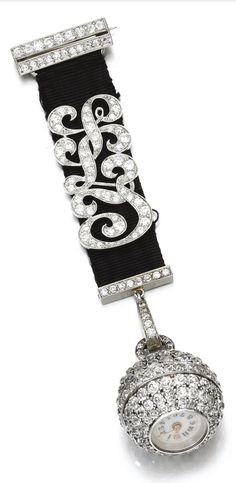 A Belle Epoque diamond pendant watch, Tiffany&Co., early 20th century. The pendant watch pavé-set with circular-cut diamonds, the circular dial applied with Arabic numerals, suspended from a black ribbon applied with the initials 'ILJ' set with similarly-cut diamonds, signed Tiffany&Co. #Tiffany #BelleÉpoque #PendantWatch