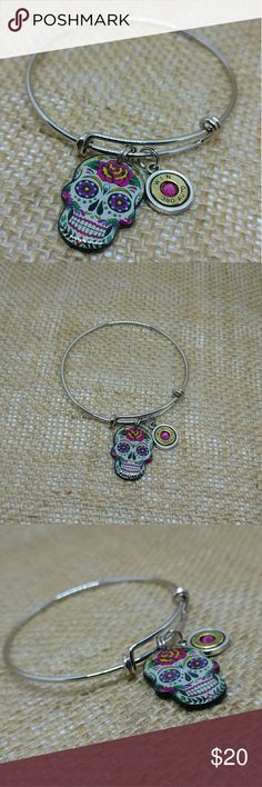 Sugar Skull .380 Bullet Bangle Bracelet Wire bangle with brightly colored sugar skull and real recycled hand-cut and polished 380-caliber bullet casing with pink Swarovski crystal center.  Handmade by me.  Variations Available Upon Request.  Bullet Jewelry Bullet Bracelet Ammunition Jewelry Ammo Jewelry Bangle Bracelet Handmade Jewelry Bracelets