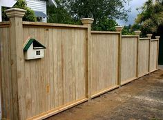 Premium Wooden (timber) shiplap fence with built-in letterbox, built by Auckland Fences.