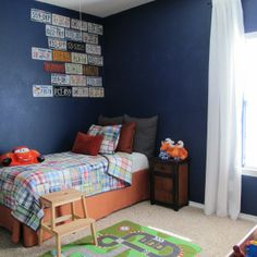 Navy blue boys room.   How simply playing around with layout can make all the difference in a room.