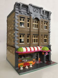 https://flic.kr/p/HdDZcn   Lego Building #8   My Lego Modular Building MOC. Built in the Café Corner style. Inspired by at the Friends 41035  Heartlake Juice Bar.