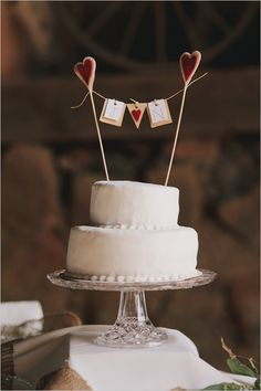 cute heart banner cake topper http://www.weddingchicks.com/2013/09/06/the-historic-santa-margarita-ranch/