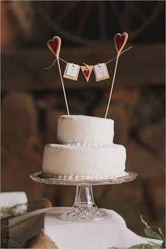 cute heart banner cake topper http://www.weddingchicks.com/2013/09/06/the-historic-santa-margarita-ranch/