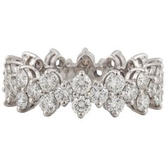 """Tiffany & Co. Diamond Platinum Aria Eternity Ring. Tiffany & Co. platinum eternity band. From the current 'Aria' series. Consists of forty two (42) round diamonds for a total weight of 2.49 carats. Stones are F/G in color and VVS-VS in clarity. Ring is a size 5.5 and resizing would be difficult. Marked on the inside """"Tiffany & Co. PT950""""."""