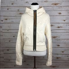 "[Free People] Cable Knit Zip Hoodie Sweater Boho Cuddle up in a richly textured and super soft cable-knit sweater with a contrast front zipper and a drapey hood. Funnel neck. Long sleeves. Braided suede zipper pull. You will want to wear this every day!  Color: Ivory Fabric: 88% Cotton 12% Nylon Size: Small Bust: 18"" Length: 20"" Condition: NWT!  No Trades! No PayPal! Free People Sweaters"