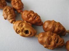 Hand carved from peach pits these are Chinese mala beads.