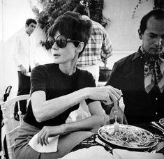 Audrey Hepburn eating pasta with Oscar de la Renta in Estoril (Cascais), Portugal, c. 1968.