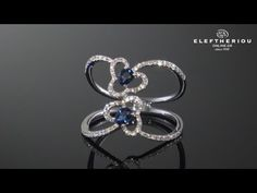 18K White Gold Ring with Diamonds and Sapphire.