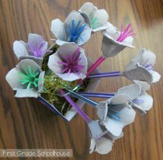 Recyclable Project - bouquet of flowers from egg cartons and colored plastic straws.