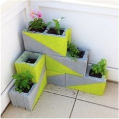 Extra concrete blocks laying around? No problem! Paint them up, they make an amazing little garden area!