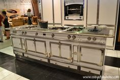 The granddaddy of kitchen ranges - La Cornue Château  with the Flamberge Rôtisserie in the background.