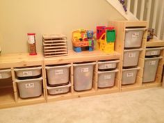 We just organized the kids' playroom! Ikea's Trofast system, adhesive business card holders (to hold labels), blank business card sheets (for the labels), a printer, imagination & patience. :) Loving it!