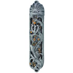 A beautifully accented 5.5 inch pewter Mezuzah. Flowers and vines are intertwined with accent stones the color of a North African sunset. Hopeful rays rise up from incredible layered detail. The depth of the display is what make this Mezuzah truly unique.  $99.95